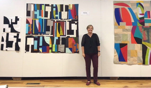 Anne Hammond in front of her contemporary quilts